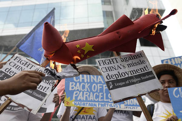 Philippine protesters condemn China's actions in the South China Sea. Noel Celis—AFP