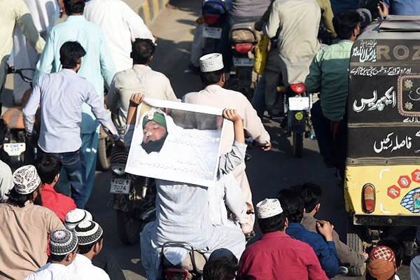 Pro-Qadri protesters rally in Karachi on Feb. 29. Asif Hassan—AFP