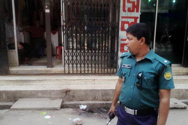 A police officer at the site of the murder. Munir uz Zaman—AFP