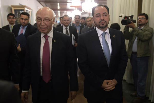 National security adviser Sartaj Aziz, left, with Afghan foreign minister Salahuddin Rabbani. Aamir Qureshi—AFP