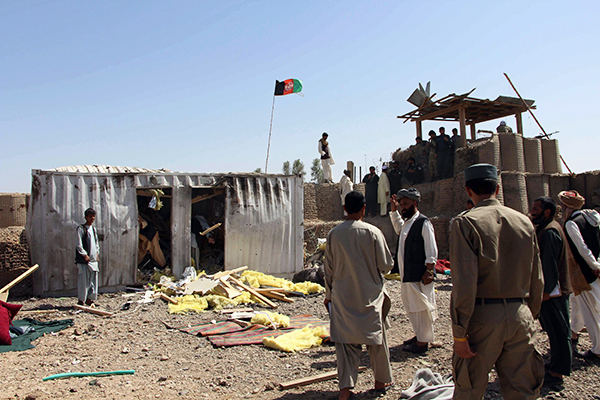 Site of a suicide car-bombing near a police-training base in Helmand, May 14. Noor Mohammad—AFP