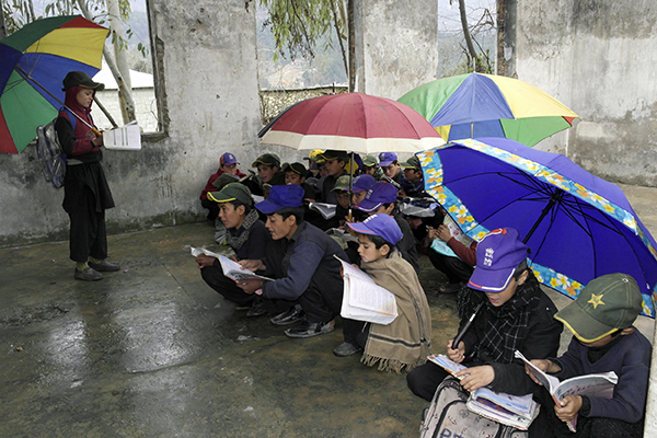 Students at a rehabilitated school in Lower Dir, March 2015. Ihsan Ullah—AFP