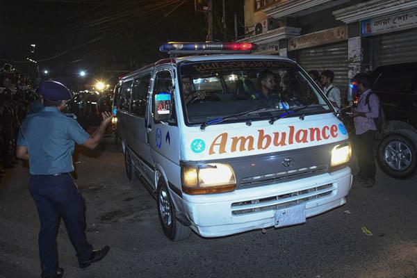 An ambulance carrying the body of Motiur Rahman Nizami leaves prison. AFP