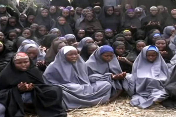 A screengrab of the missing girls from a video sent by Boko Haram militants. AFP