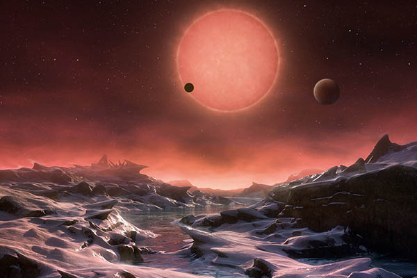 An artist's impression of the view from the surface of one of the three planets.