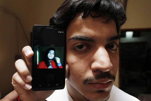 Hassan Khan shows a picture of his deceased wife, Zeenat Bibi. AFP