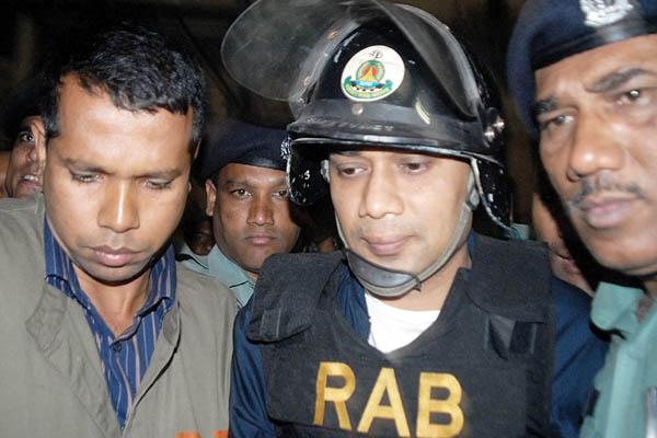 Police escort Rahman (center) to court in 2007. Farjana K. Godhuly—AFP
