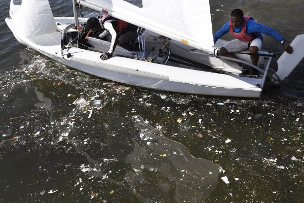 Sailors train in waste-littered waters at Rio de Janeiro's Guanabara Bay. William West—AFP