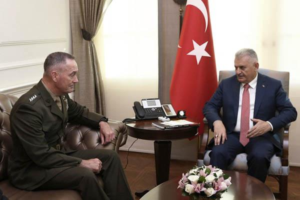 Hakan Goktepe-Turkish Prime Minister Press Office—AFP